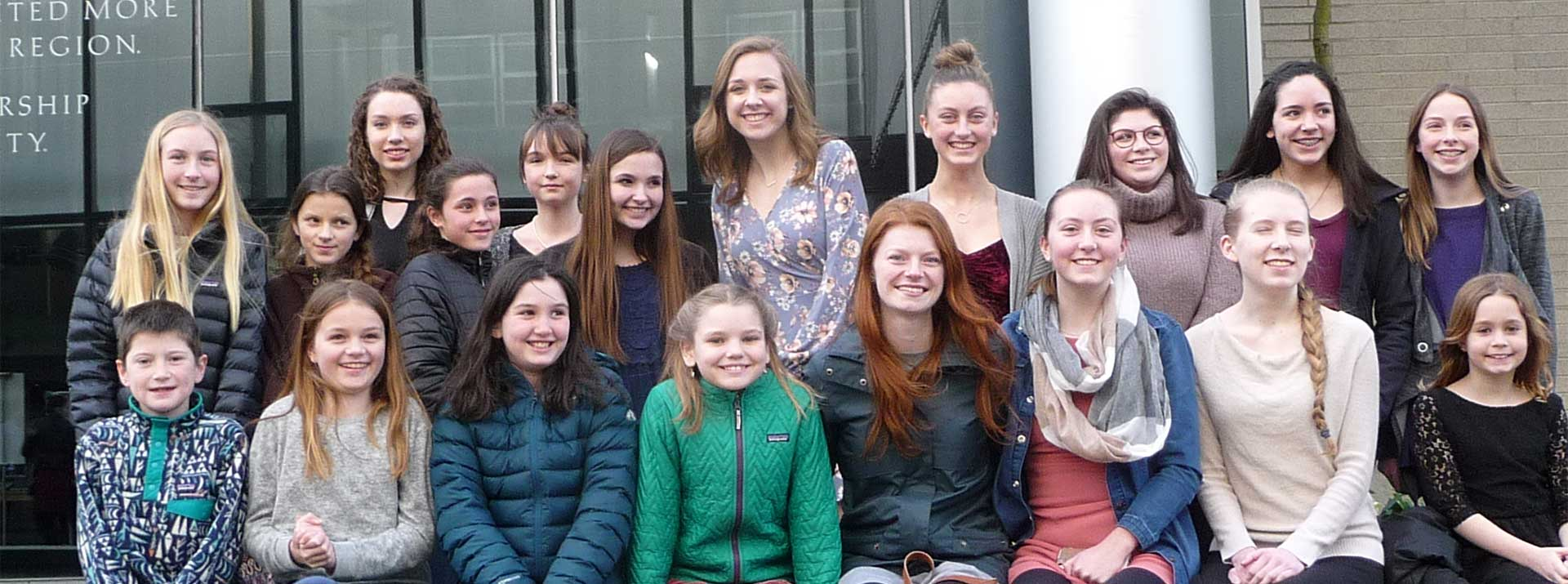 Dancers in street clothes on a field trip with Garden City Ballet